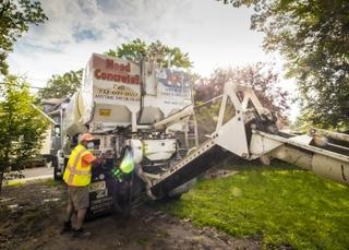 The drivers at Quality Concrete are great at getting the trucks through tight spaces to get a close as possible to the area that is being poured. This makes it easy for the contractor to get the concrete from the truck to the sections they are working on.