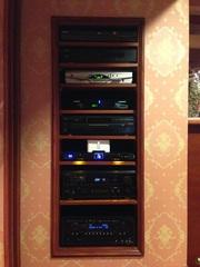Equipment rack complete with everything you need for the ideal home theater room. Nice and neat.
