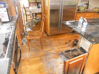 The dust from the fire is visible in this kitchen and it gets everywhere and needs to be properly cleaned to return the home contents and structure to its original condition.
