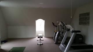 The remodeling experts at LG Building and Remodeling installed this in-home gym, providing the homeowner with the perfect fitness space.