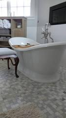This bathtub is the central feature of the bathroom remodel, featuring a classic look with modern function.