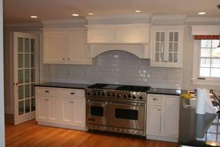 We installed a simple, classic white subway tile backsplash for this kitchen remodeling project.