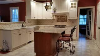 The completed kitchen remodeling project, including a kitchen island and beautiful countertops.