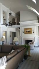 This beautiful living room received a remodeling upgrading with a new balcony that overlooks the room.