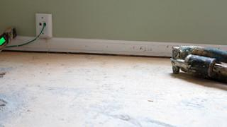 The concrete slab was sinking over time creating a problem for new flooring.