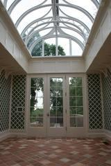 LG Building and Remodeling installed this beautiful arched entranceway with a glass ceiling.