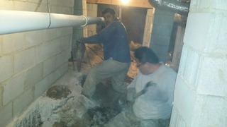Our foreman Sixto removing the concrete around the wall in order to install the push piers.