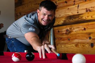 Owner William takes his shot during a friendly game of pool with some of our Production Team members.