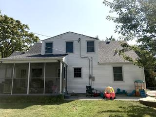 """As you can see, Arrow Renovation installed a new roof along with 89 feet of 5"""" gutters with leaf guards."""