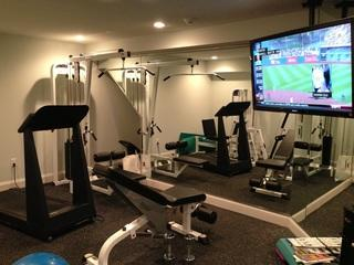 Updated the home gym with a new flat screen TV and added music to enjoy while working out.