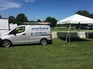 Setting up our booth for the day at the Greenwich Polo Club.