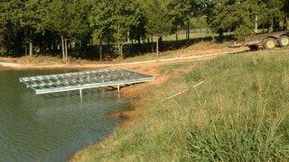 Installed Helical Piers to stabilize a boat dock in Edmond, Oklahoma