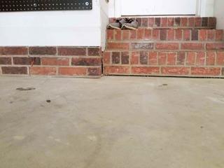 All around the garage were gaps where the concrete had begun to sink.
