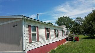 A new roof and gutters were installed on this mobile home.