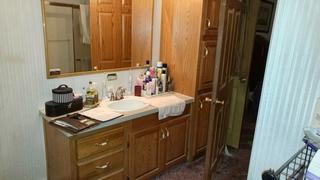 This drab vanity was not impressing anyone.