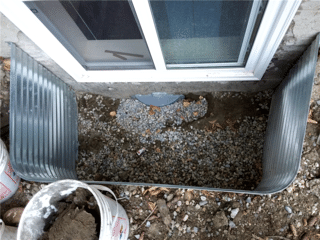 Here is a view of the WellDuct® Collector that will prevent this Window Well from flooding. To complete the install the collector needs to be covered with gravel.