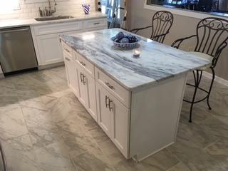 A white island was installed to match the kitchen cabinets.