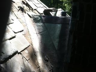 This roof was clearly in need of repair, as the valley and the slates around it had been damaged over time.