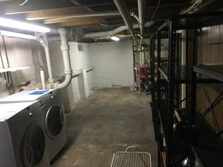 We were called in on this project for seepage. The basement was finished on one side and used as storage on the side with the seepage