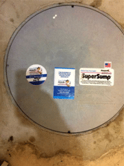 This is a view of the SuperSump® Pump system installed with a flat lid. The flat lid allows the homeowner to hide the sump system when they refinish their basement.