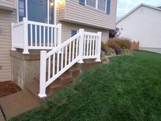 This Dynasty White Vinyl Hand Rail & Stair Rail with Post Mount accentuate the entrance to this home.