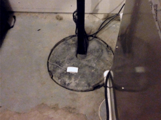 Here is a view of the Sump System that needed to be replaced. This system couldn't keep up with the amount of water that was entering their home.
