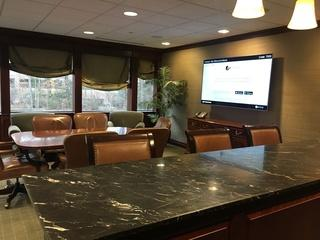 At Barnum Financial Group in Shelton, CT. we updated their conference room with a mounted 65 inch, complete automation with a Crestron Touchpanel on the wall.