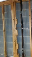 This is a great picture that clearly shows how this basement wall is bowing. Notice the distance between the wall and the wood beams at the bottom of this picture and compared to the top of the picture. This basement wall was bowing right below a load bearing wall. This caused the entire master bathroom to settle.