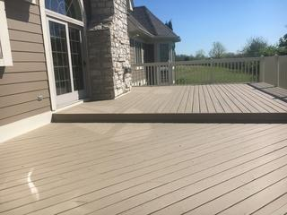 Tired of painting their deck every few years, these folks turned to Rhino Shield for a deck coating guaranteed for 10 years.  Now they spend more time enjoying the deck and less time painting it.