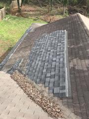 Here you can see a different color was used to patch a section of the roof in previous years.