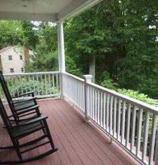 Beautiful customized Boral railings were installed to brighten up the front porch for this homeowner.