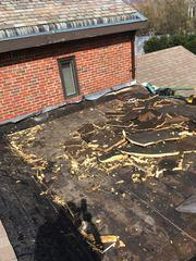 Our crew starts the project by removing the damaged flat roof, from the rubber top layer all the way through the water damaged underlayments.