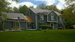 We re-roofed and installed new gutters and downspouts on this beautiful home in Monroe, Ct. It came out great!
