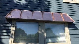 Gorgeous accent using copper standing seam metal roofing