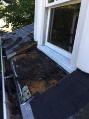 The damage to the wood from rot and water is evident, and you can see why this section of the roof is being replaced.