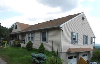 This 20-year-old asphalt shingle roof had some small leaks and issues.
