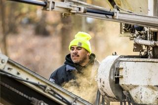 Our truck allows Carlos to control the texture in the concrete to create the perfect pour for the basketball court.