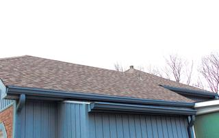 """6"""" gutters installed along with 6 down spouts which were colonial blue color."""