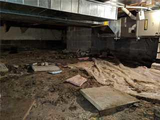 A before picture of the crawl space