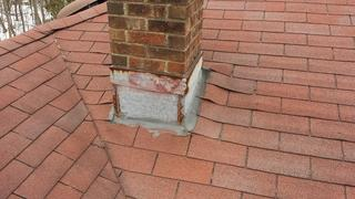 You can see here waves in the shingles around the chimney.
