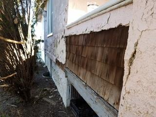 The stucco siding trapped moisture which ate away at the wood underneath.