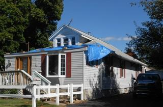 The leaks in this roof were so severe, the homeowners had to use a tarp to prevent water from getting in.