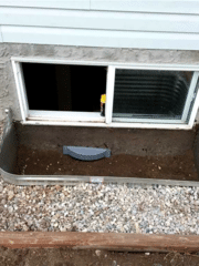 Here is a look at the WellDuct® Collector Drain that will prevent this window well from pooling in the future. Any excess water will travel down into the the WellDuct® Track on the inside of the basement and down into the installed WaterGuard®.