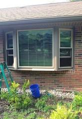 This two-toned bay window was quite outdated. The customers wanted a more modern look.