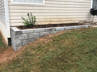 Here we have installed the new retaining wall.