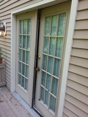 If you look closely, this patio door has missing pieces and cracks and chips.