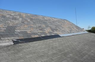 The old slate of this roof held up a long time, but pieces were starting to fall out and leak