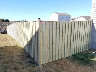 Treated Board N Batten style Fence installed in Winchester, VA. 1 day installation.