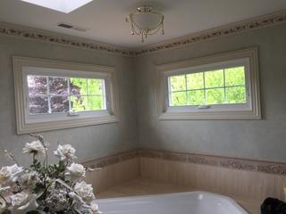 This photo shows custom awning windows installed in the bathroom.