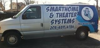 When our technicians arrive at your home they will be in our company van.  And our van looks like this. Our technicians also wear logo'd shirts with the Smarthome & Theater name on it.  Feel comfortable knowing its easy to identify our technicians when they come to your home. Our van was wrapped by the great folks at Sign-A-Rama Orange, CT.  If you need similar work, I highly recommend them.  Contact Dave here: sales@signs-ct.com.